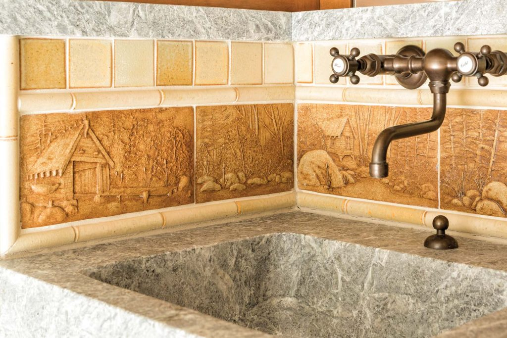 This stone sink shows incredible attention to detail with a hand-drawn, 180° panoramic depiction of the camp.