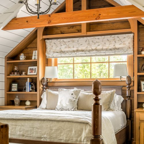 The custom-made bed frame is complete with acorn finials, representing the oak trees still situated around the camp.