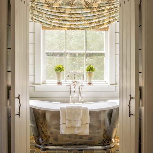 The master bathroom has a beautiful, antique nickel soaking tub by Kenedy Waterworks.