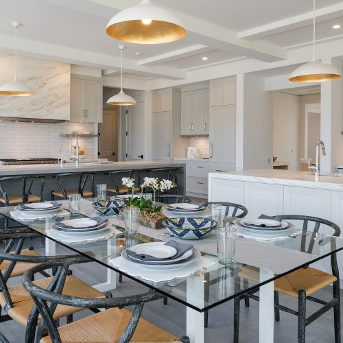 The heart of the home is an open, multi-functional, multi station kitchen with miter-cut, stone breakfast table.