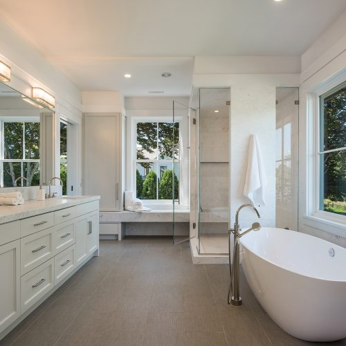 The master bath offers an expansive vanity, soaking tub, multi-head steam shower. The cloth-like, heated, porcelain floors warm your feet and feel like walking on freshly-laundered linen.